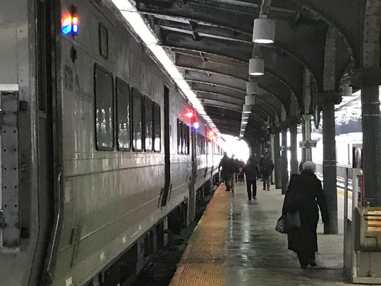 Commuters get ready to board a NJTransit train to Waldwick at Hoboken Terminal.