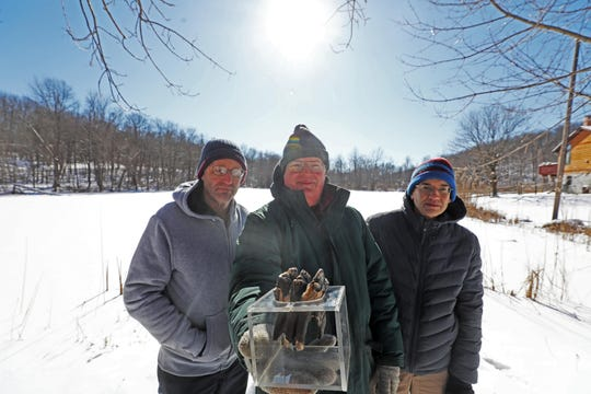 Research scientist Scott Stanford, New Jersey State Geologist, Jeffrey Hoffman holding a mastodon tooth, and author of a report on mastodons inn NJ Ted Pallis, Geographical Information Specialist stand by Mastodon Lake in Vernon on January 31, 2019. They told the story of a mastodon skeleton that was found in the lake in 1954. It is part of a statewide report on the history of NJ mastodons.