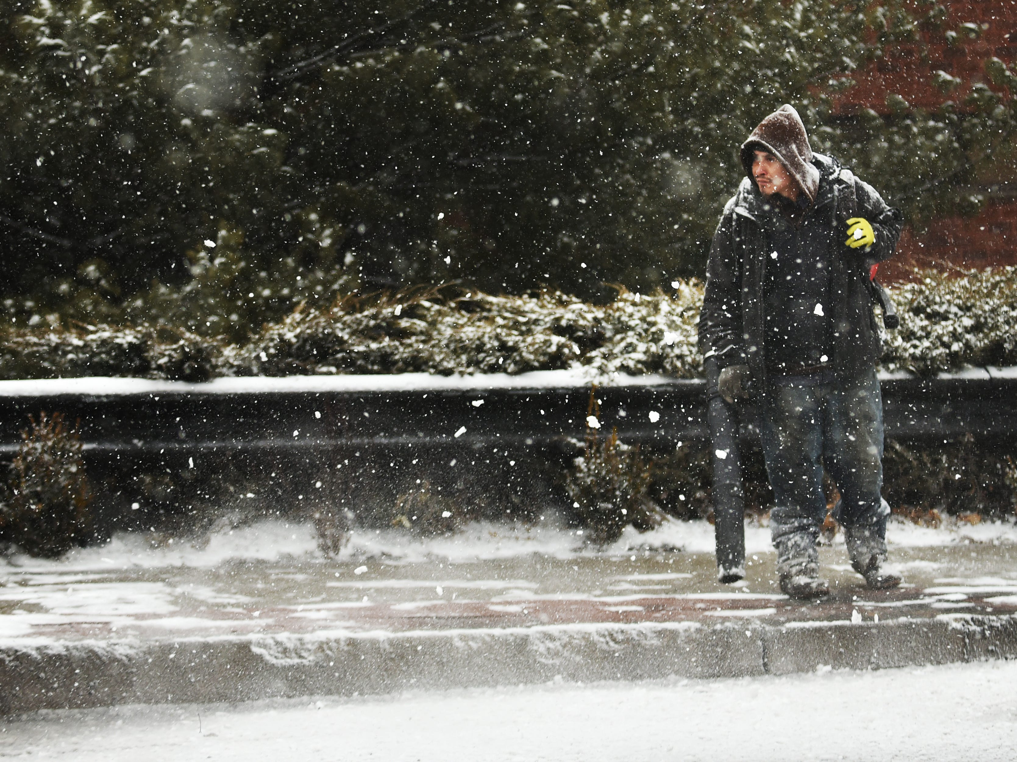 A man clears snow from the sidewalk with a snow blower along Cedar Lane in Teaneck on Wednesday February 20, 2019.