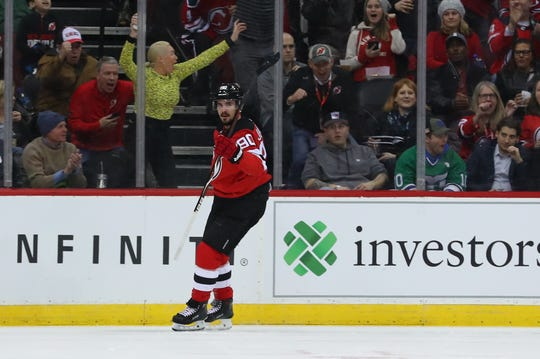 Feb 19, 2019; Newark, NJ, USA; New Jersey Devils left wing Marcus Johansson (90) celebrates his goal during the first period of their game against the Pittsburgh Penguins at Prudential Center. Mandatory Credit: Ed Mulholland-USA TODAY Sports