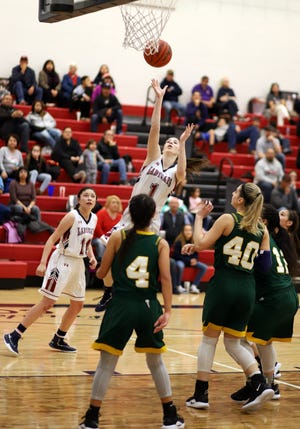 Sophomore Lady 'Cat Sierra Manos (1) provided instant offense Tuesday to lead the Lady 'Cats with 14 points in a 45-41 District 3-5A loss to the Mayfield High Trojans.