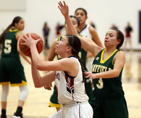Senior Lady 'Cat forward Adriana Giron worked the interior of the Trojans' defense for 8 points on Tuesday.