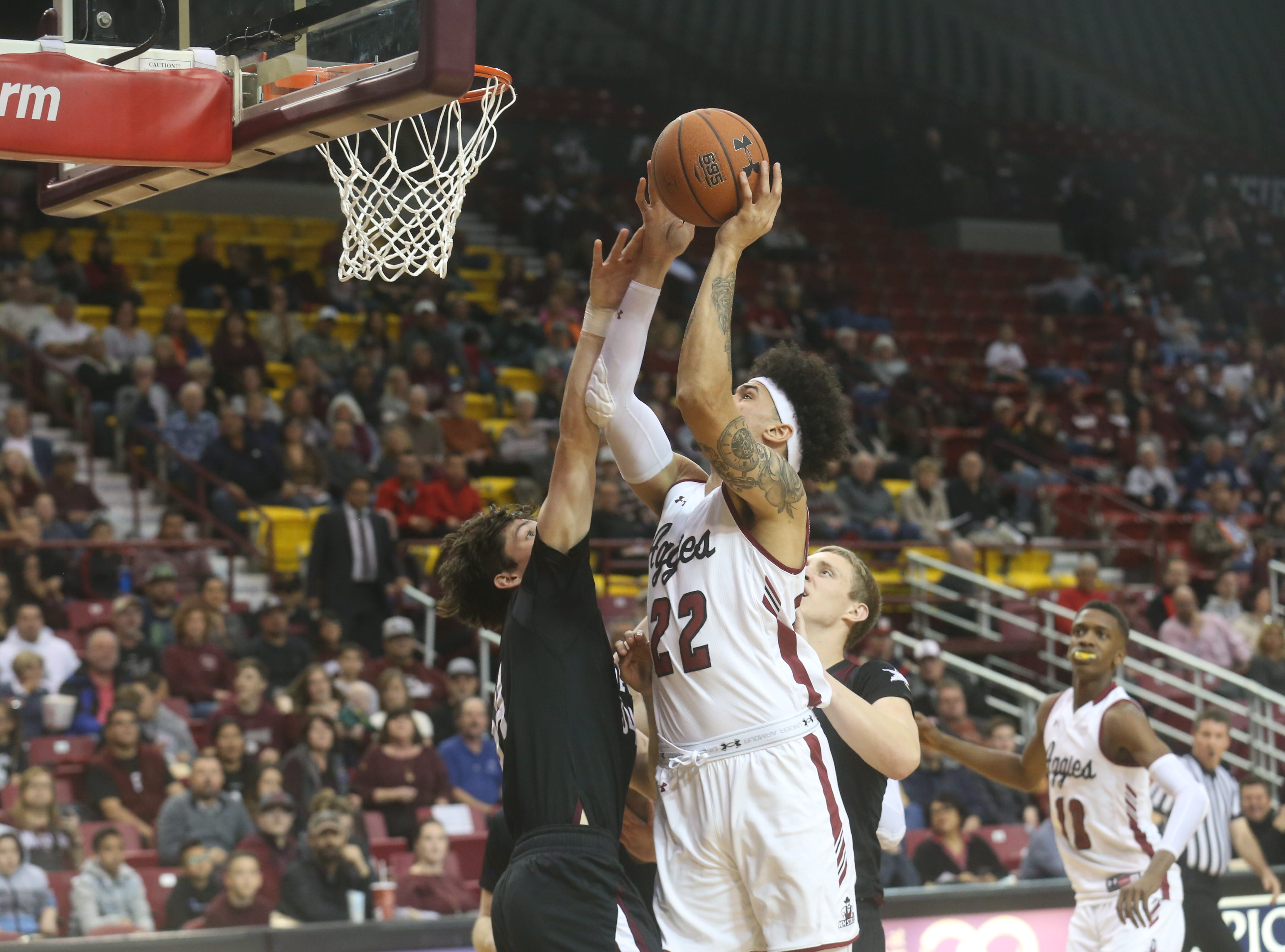 Eli Chuha rises above a Texas A&M International defender during the Aggies win over the visiting Dustdevils on Feb. 20.