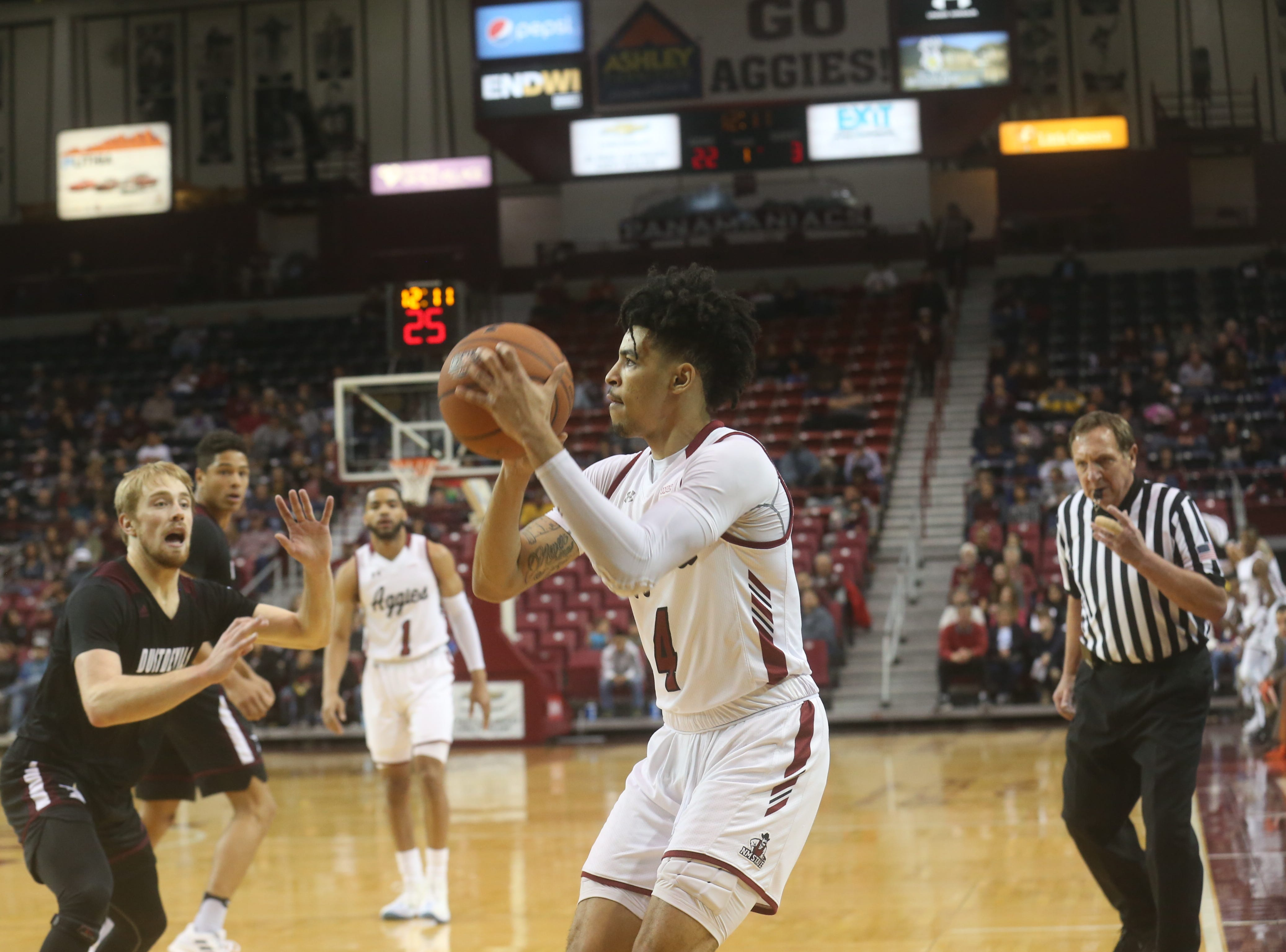 Aggies' JoJo Zamora finds an open shot in the second half against Texas A&M International.