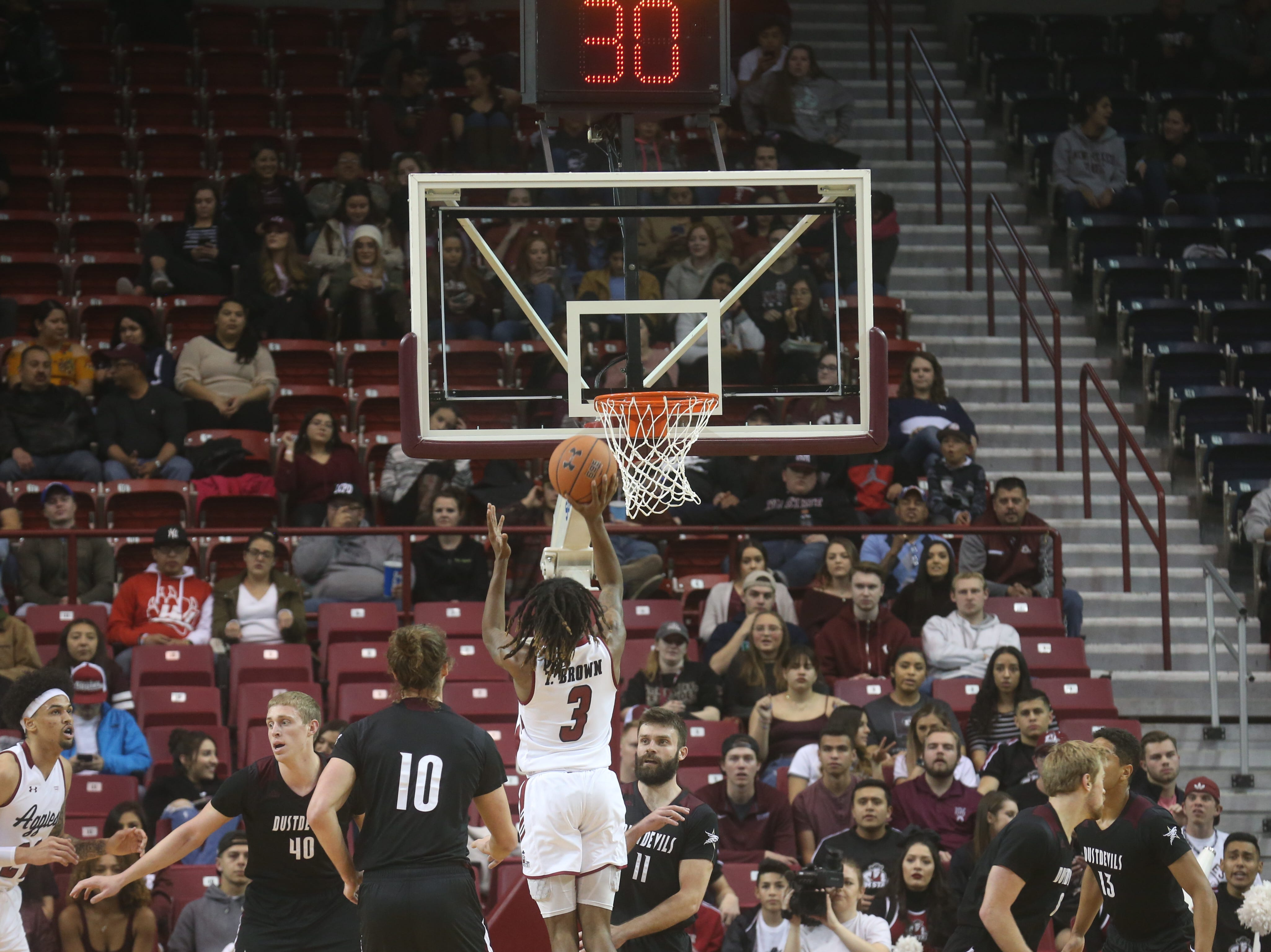 NMSU's Terrell Brown hits a jump shot during the first half of the Aggies' game against Texas A&M International.