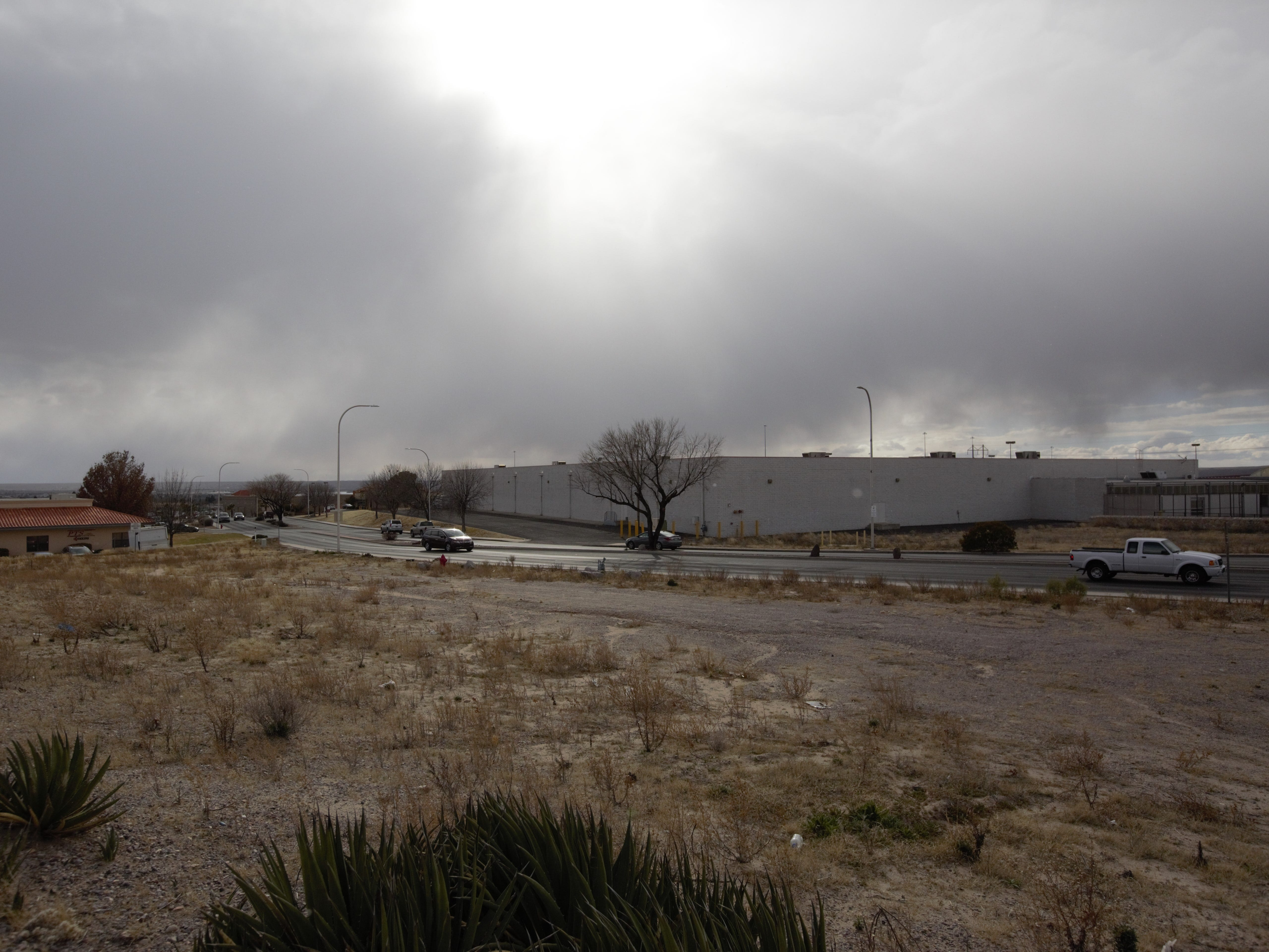 Traffic passes by on Telshor Boulevard in Las Cruces, as the sun breaks through a patch of clouds on Tuesday, Feb. 19, 2019. The day was marked by mixed sunshine and snow flurries.