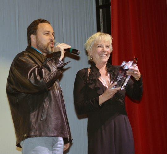 "Actress Kathleen Quinlan receives ""The Sweetheart Award"" during a Las Cruces International Film Festival event at the Rio Grande Theatre. Quinlan was presented the award by Ross Marks, left, who is Mark Medoff's son in law."