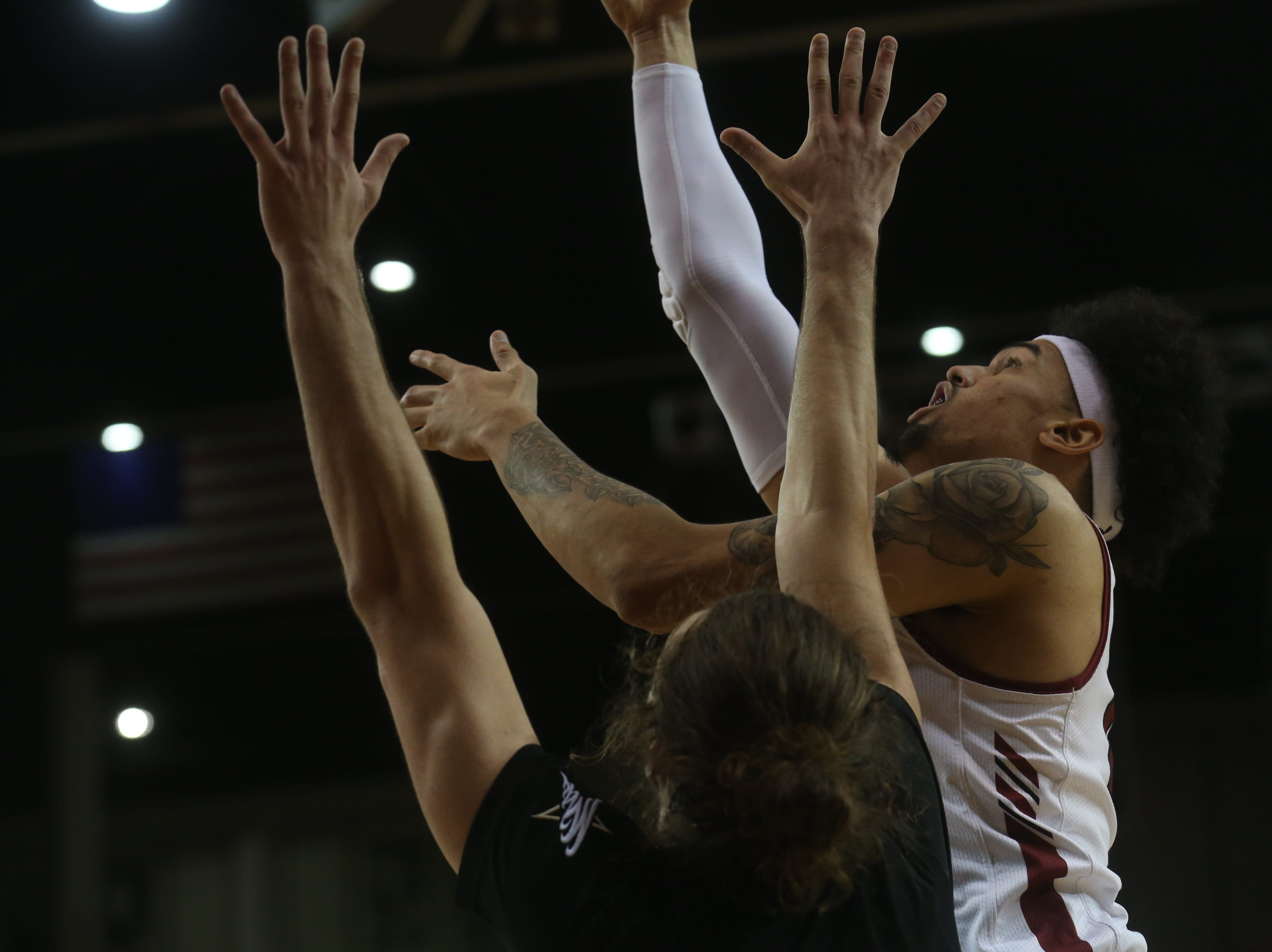 New Mexico State University's Eli Chuha powers his way to the basket before being fouled in the Aggies' non-conference game against Texas A&M International University Feb. 19 at the Pan American Center.