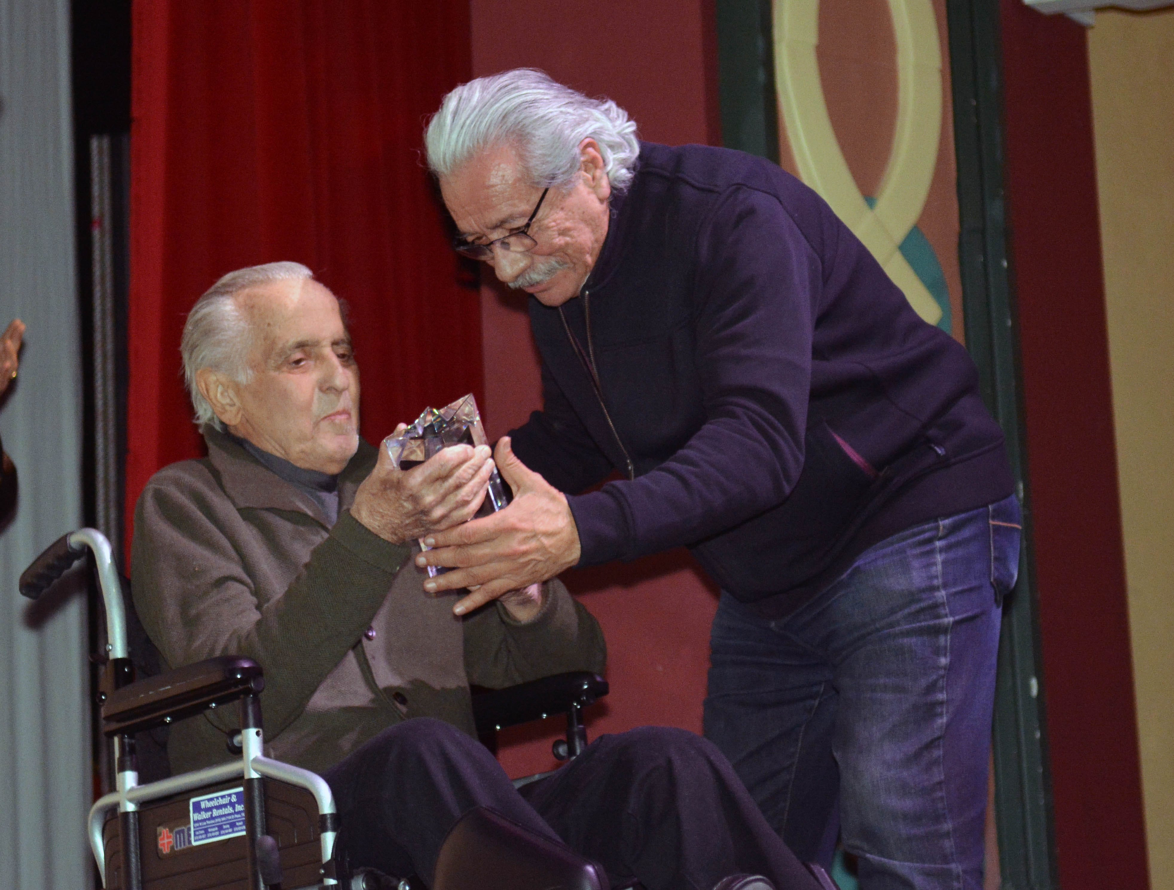 """Mark Medoff, left, presents Edward James Olmos with the Las Cruces International Film Festival's Mark Medoff Humanitarian Award at Tuesday's screening of """"The Ballad of Gregorio Cortez"""" at the Rio Grande Theatre."""