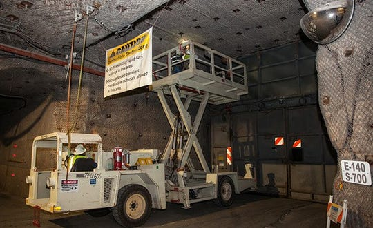 Repairs are made to an airline connected to the airlock doors at the Waste Isolation Pilot Plant.