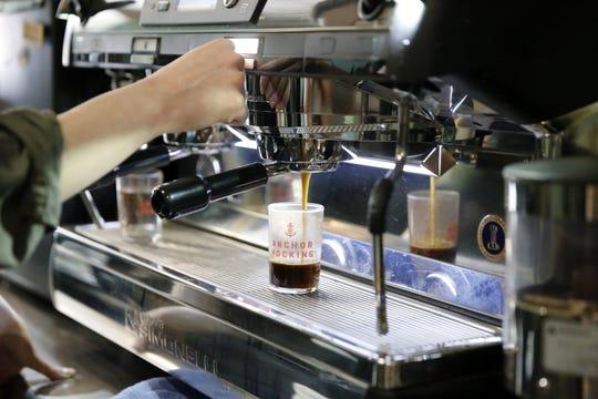 Ren Harris prepares a beverage Wednesday at Cosmic Cafe in Farmington.