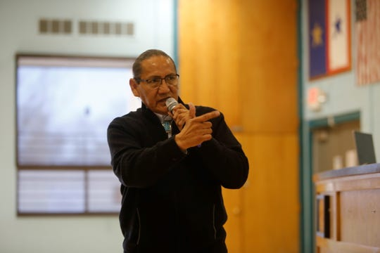 Edward Dee, director of the Office of Navajo Government Development, explains the purpose of the listening session on Navajo government reform on Wednesday at the Shiprock Chapter house.