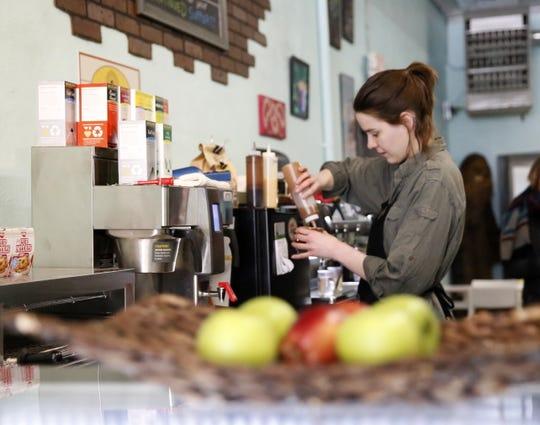 Ren Harris prepares a beverage Wednesday at Cosmic Cafe in downtown Farmington.