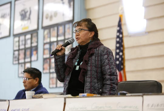 Ramona Begay, a commissioner on the Commission on Navajo Government Development, introduces herself during the listening session on Wednesday at the Shiprock Chapter house.