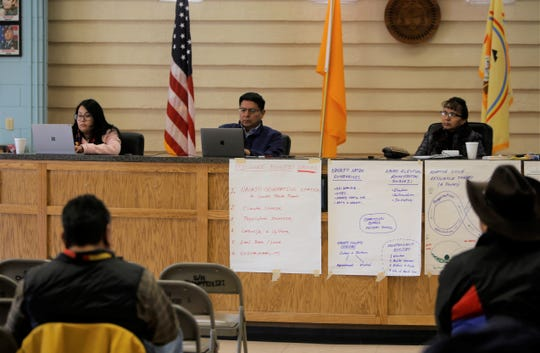 From left, Navajo Government Development Commissioners Rachel Felix, Henry Fowler and Ramona Begay listen to comments about the structure of the tribal government on Wednesday at the Shiprock Chapter House.