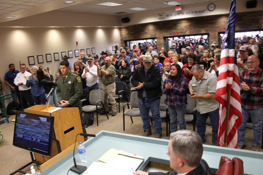 Crowds filled the San Juan County Commission chambers today as Sheriff Shane Ferrari presented a resolution stating the Sheriff's Office will not enforce certain gun control legislation.