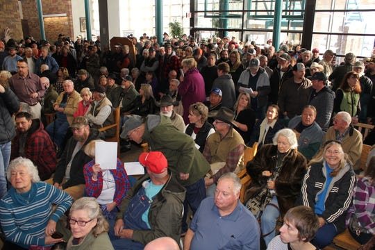 A crowd fills the foyer outside the County Commission chambers today as commissioners discuss state gun control legislation.