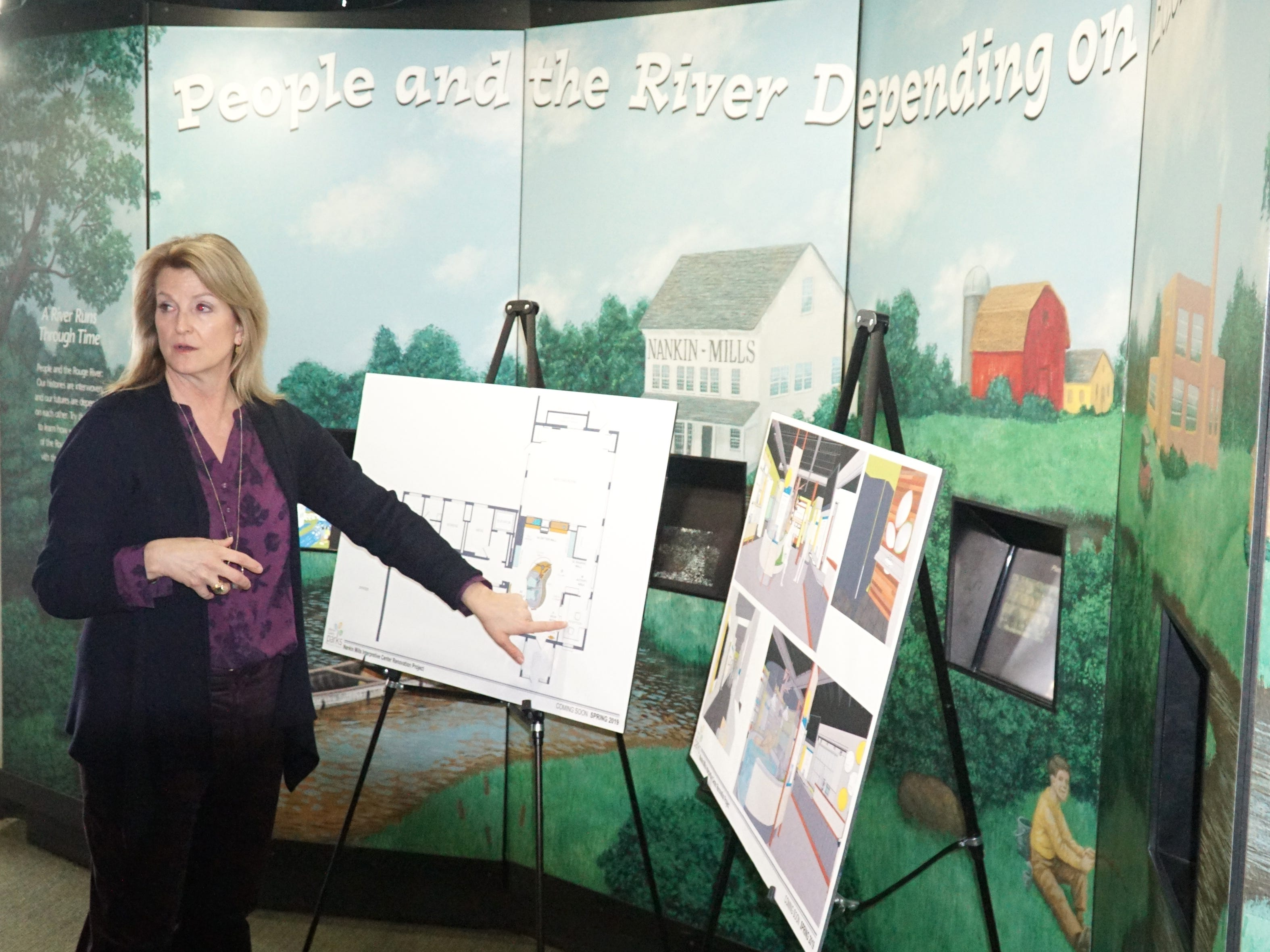 Elizabeth Iszler, Chief of Planning at Wayne County Parks, goes over some proposed renovations of the county's Nankin Mills Interpretive Center on Feb. 20. The nearly quarter million update will mean more interactive and updated displays at the center off Ann Arbor trail in Westland.