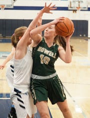 Kaylee Wendel tries to get a shot up against some Livonia defense.
