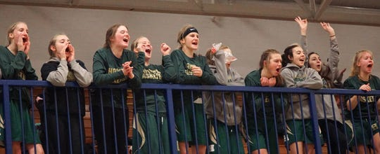 Members of the JV Howell Highlanders cheer on their varsity squad on Feb. 19.