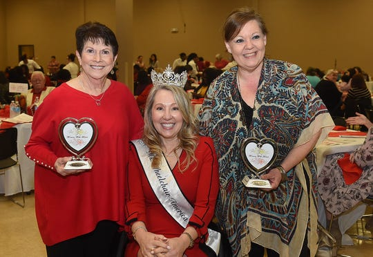 Susie Peck. left, and Connie Lamke, right, were presented the Women With Heart award at the annual luncheon held Friday, Feb. 15, at the Opelousas Civic Center. The event is sponsored by the St. Landry-Evangeline United Way.