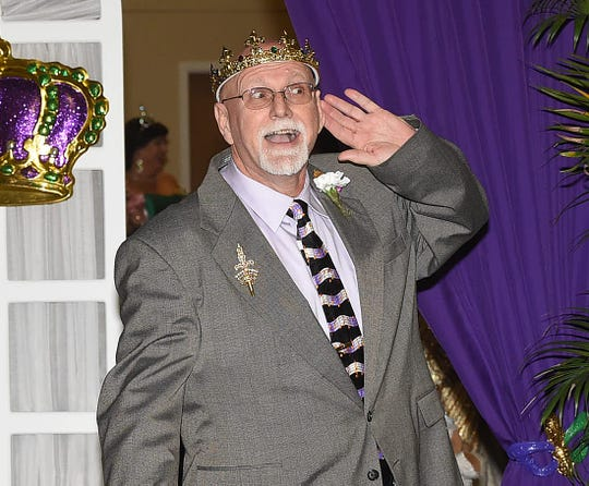 King  Orme 2000, J.P. Poirer, listens to the roar of the crowd as he is introduced at the 73rd  Mardi Gras Bal Masque.
