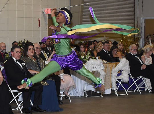 Dancers from the Fontenot Dance Theatre Conservatory entertain at the 73rd     Mardi Gras Bal  Masque sponsored by the Opelousas Garden Club.
