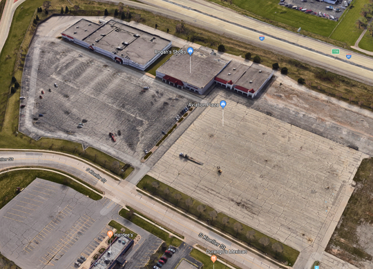 An aerial view of Aviation Plaza along South Koeller Street shows the former JCPenney building on the left, Rogan's Shoes in the middle and on the right a plot of land where Walmart used to be.