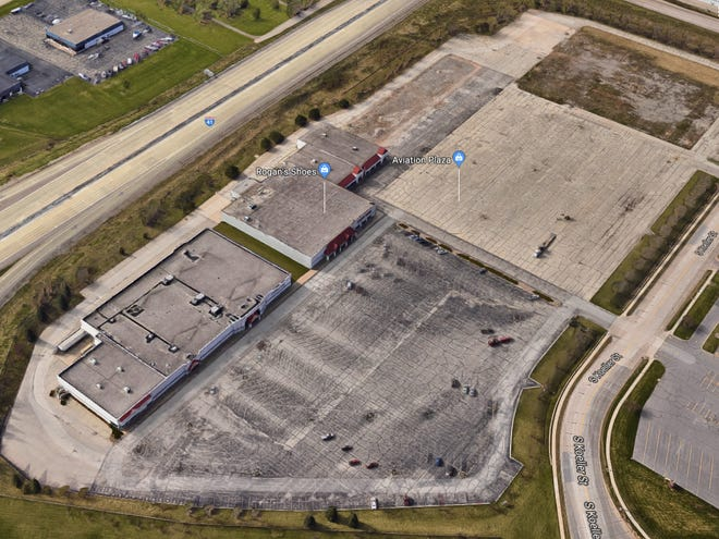 An aerial view of Aviation Plaza shows the former JCPenney building on the left, Rogan's Shoes in the middle and a plot of land where Walmart used to be.