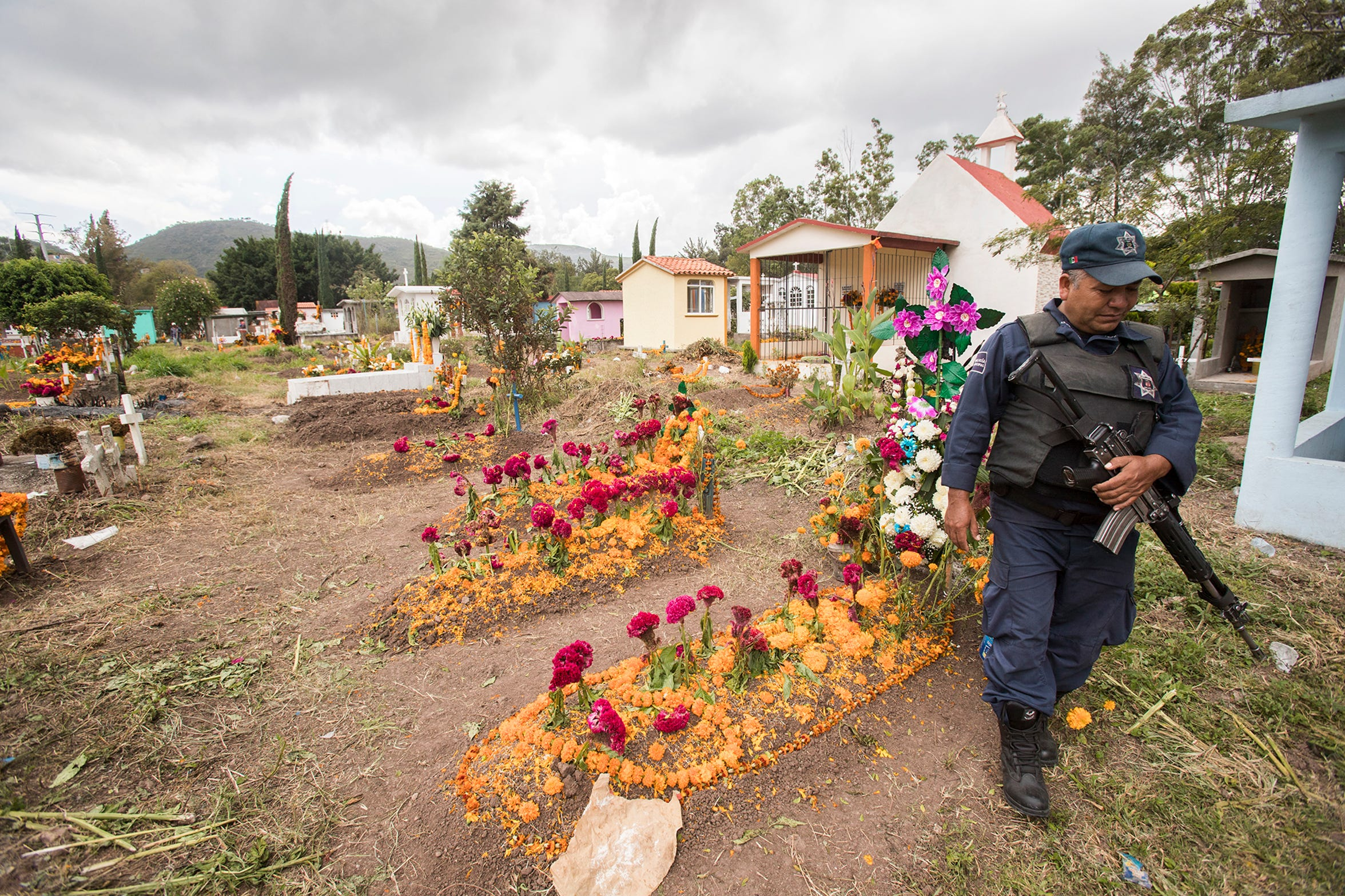 Chilapa has one of the highest homicide rates in the country. The police patrol the municipal cemetery on Day of the Dead.