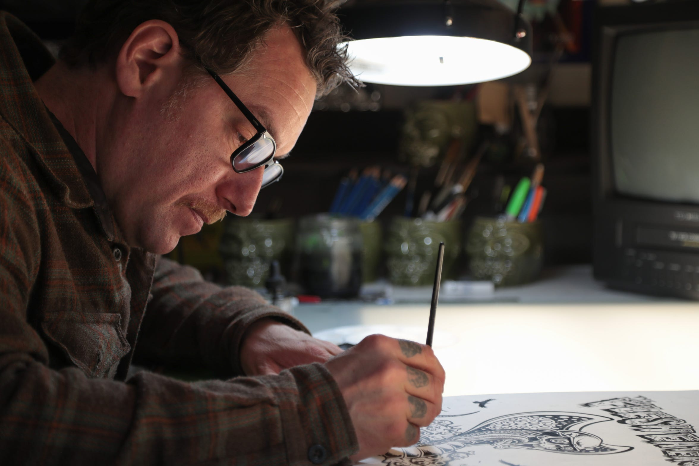 Artist Donny Gillies, photographed working in his studio in Palm Desert, has become a leading artist of pinball game designs, Palm Desert, Calif., February 13, 2019.