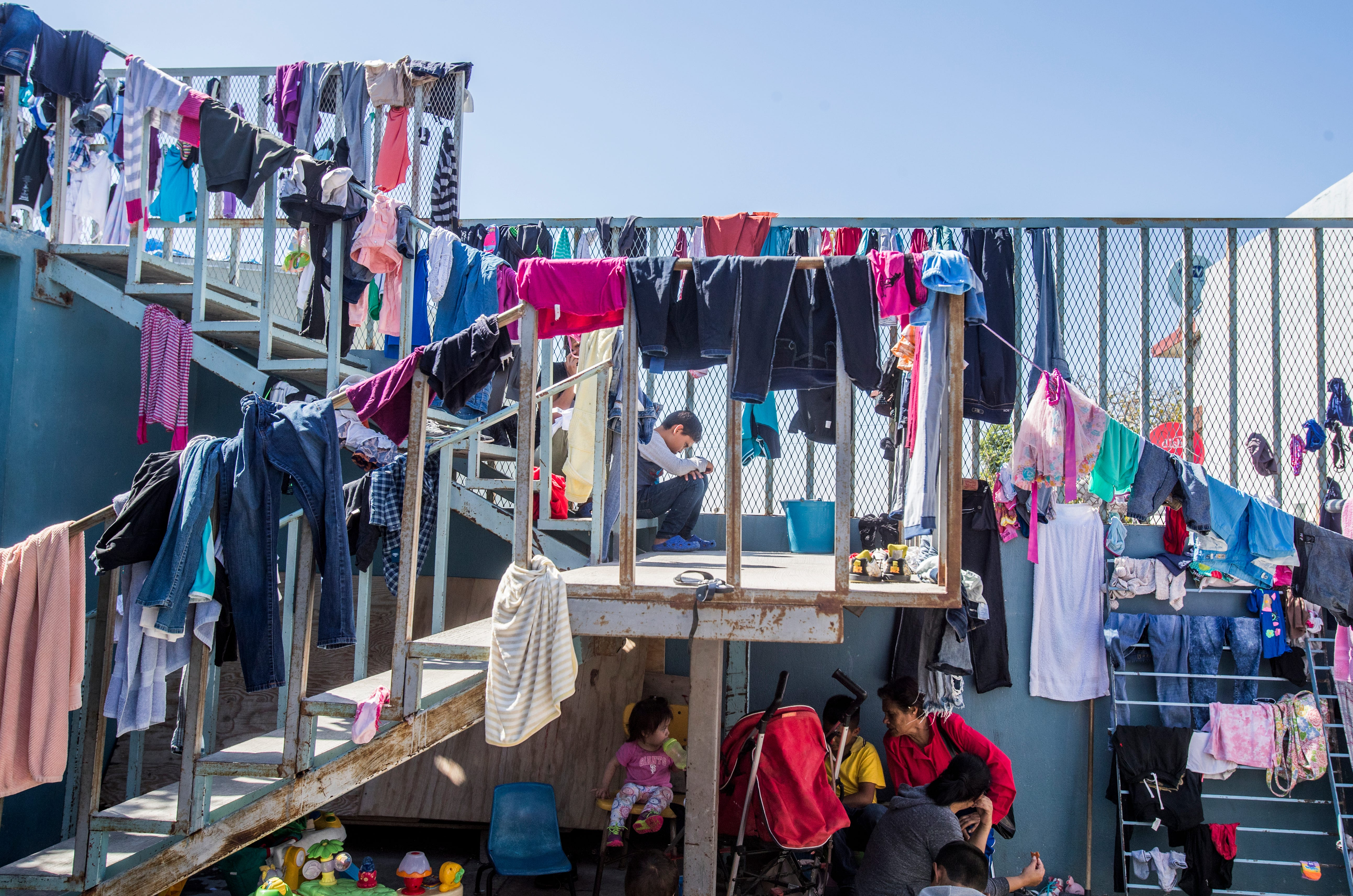 In Tijuana, the poorest asylum seekers bide their time in shelters, where they do their laundry and eat communal meals.