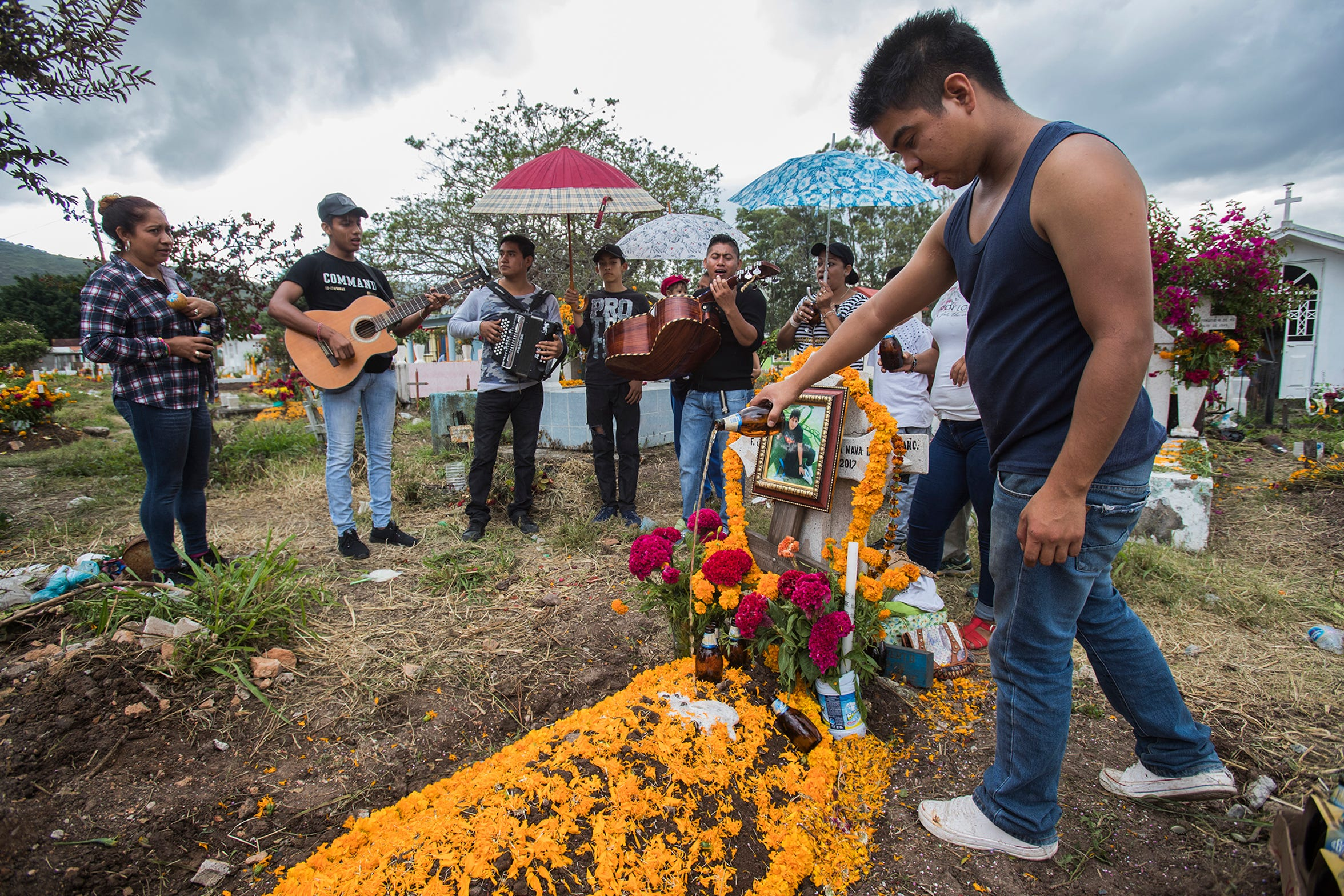 On Day of the Dead, families gather in the Chilapa cemetary to memorialize a young man killed by a cartel.