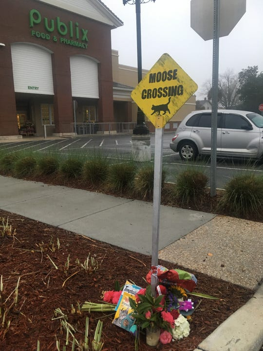 A makeshift memorial was made for Moose the East Hill Publix cat, who died over the weekend near the 1100 E. Cervantes Publix in Pensacola.