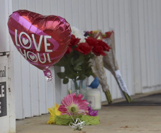 A makeshift memorial outside the Quick Fill gas station in Pensacola on Wednesday, Feb. 20, 2019, pays tribute to Govardhan Kotha, who was shot and killed on Tuesday, Feb. 19, 2019.