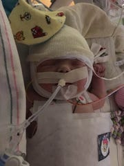 Ellie DeBoard, whose parents live in Navarre, was born with a rare heart defect and will be unable to leave Shands Hospital in Gainesville for six to eight months.