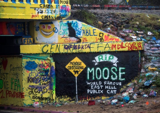 A mural on the Graffiti Bridge pays tribute Wednesday to Moose, the cat who was often spotted outside the East Hill Publix.