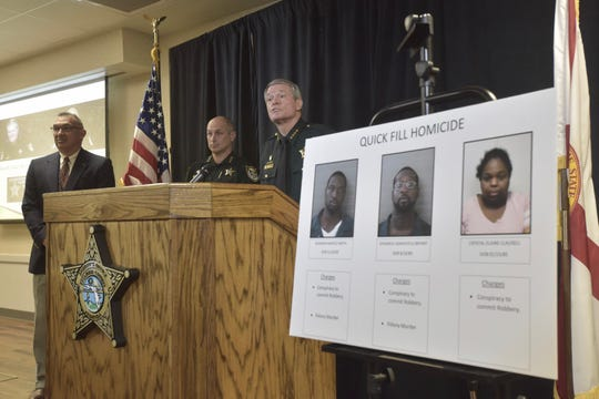 Escambia County Sheriff David Morgan, right, holds a press conference Wednesday, Feb. 20, 2019, to announce that three people have been arrested in connection to a robbery and murder at a Pensacola gas station.