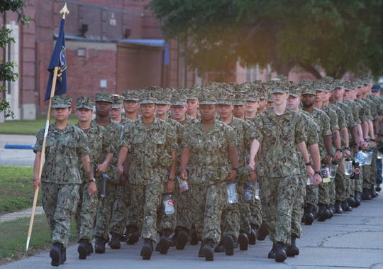 Students attending courses at Information Warfare Training Command Corry Station march to class at the beginning of their day May 22, 2018.
