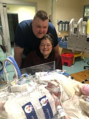 Will and Tiffany DeBoard pose with their newborn daughter, Ellie, at Shands Hospital in Gainesville on Monday, Feb. 18. Ellie was born with a rare heart defect and will be unable to leave Shands Hospital in Gainesville for six to eight months.