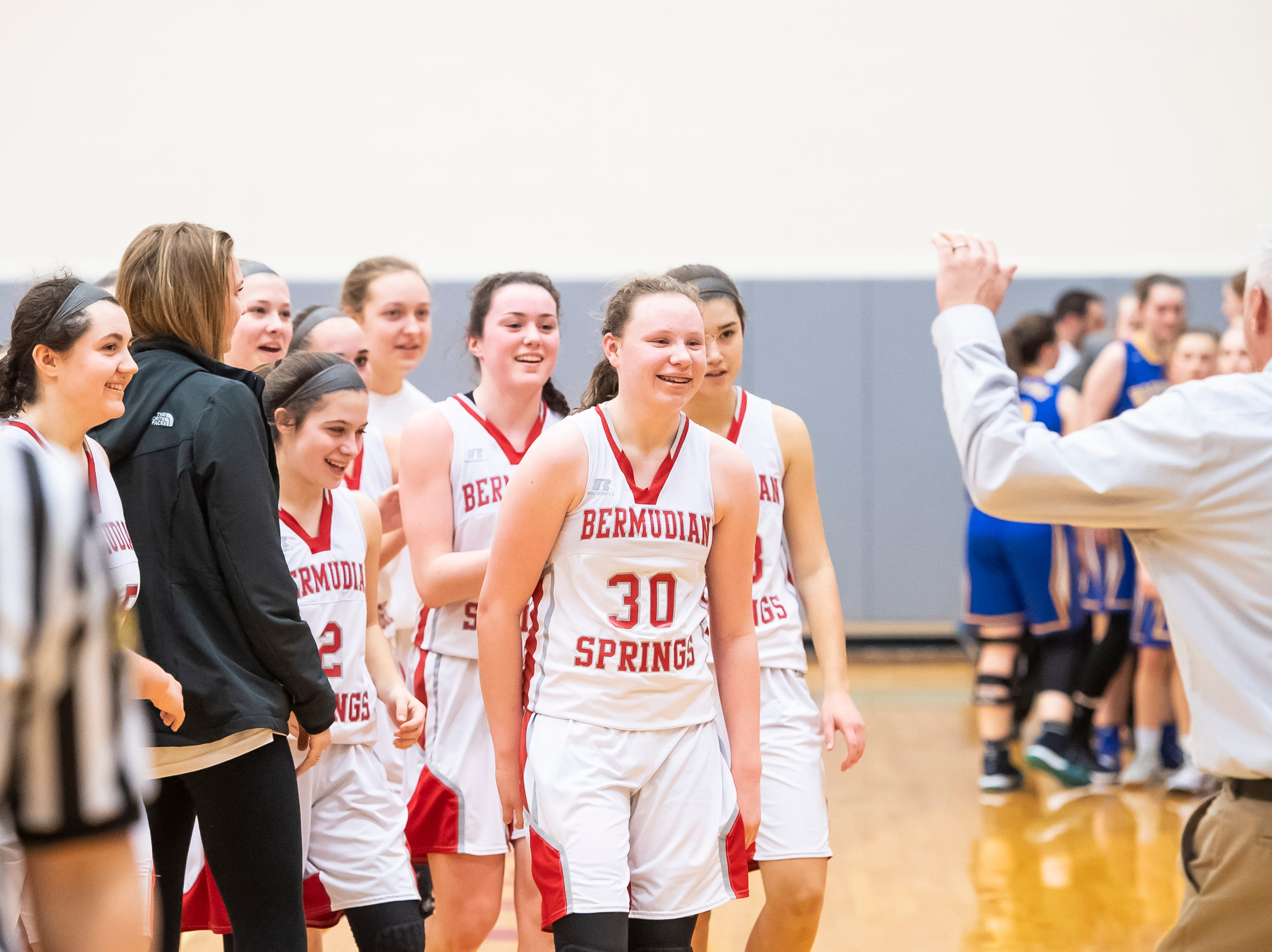 Bermudian Springs players head to the sideline after downing Northern Lebanon in the first round of the District III 4-A playoffs Tuesday, February 19, 2019. The Eagles won 58-52.