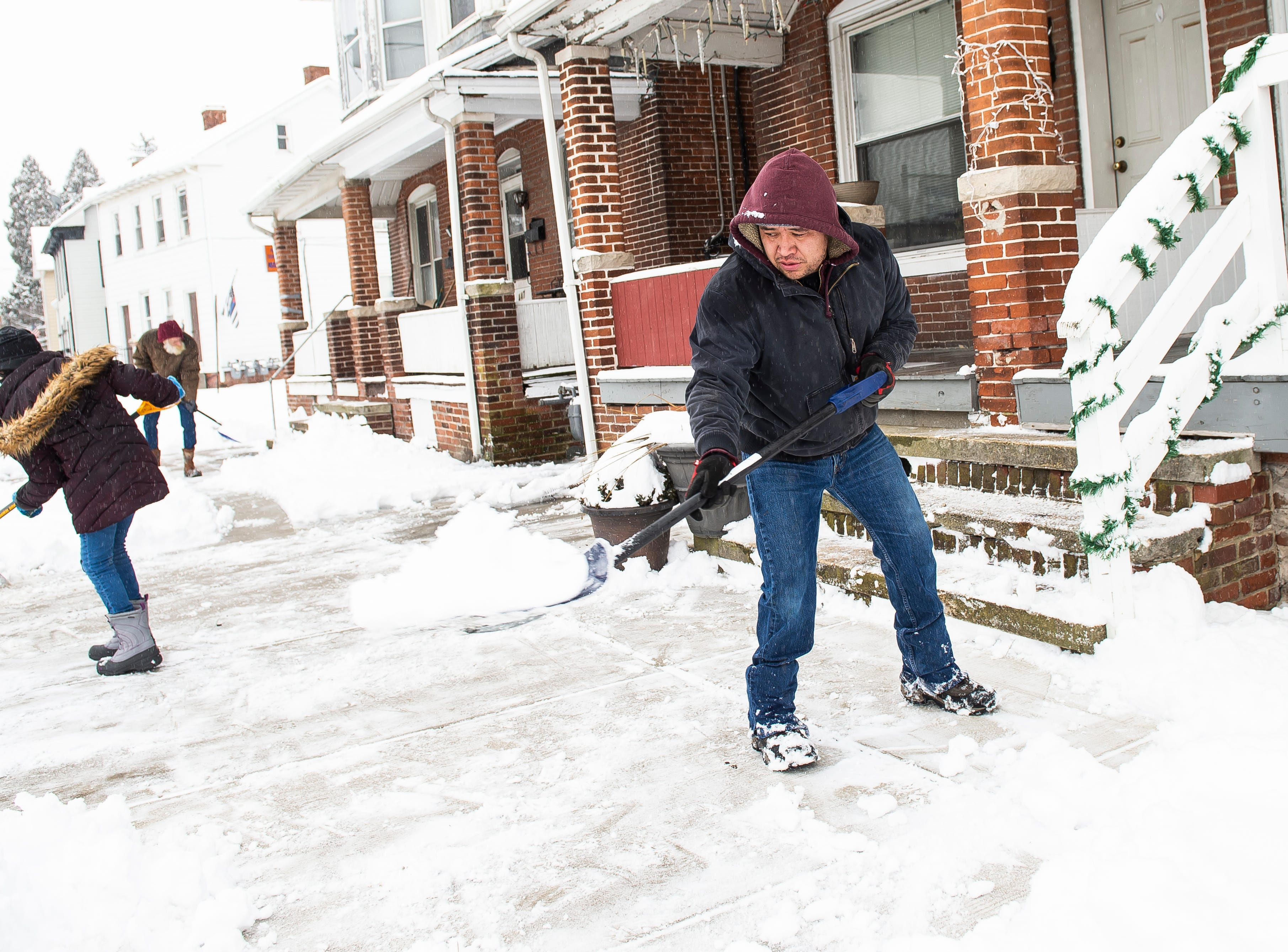 Alberto Diaz and his daughter, Athena Diaz, shovel snow from a sidewalk along York Street in Hanover Borough Wednesday, February 20, 2019. The National Weather Service reported that Hanover received four inches of snow as of 1:31 pm.