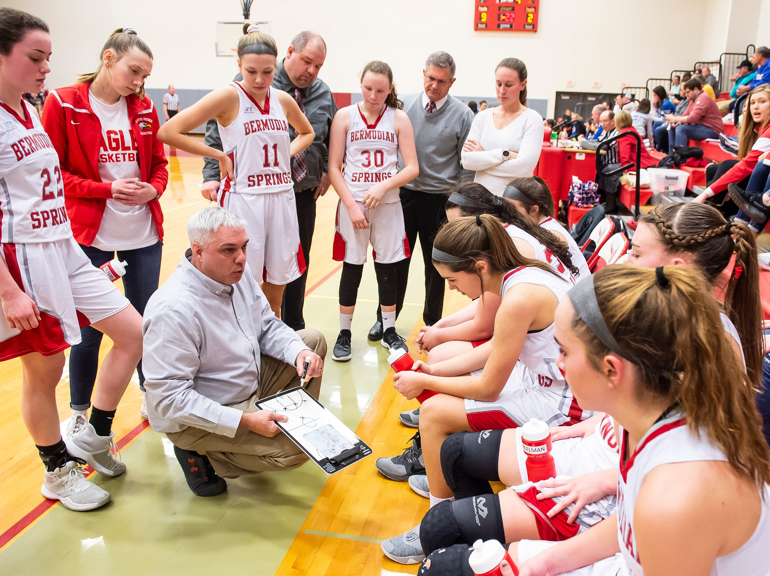 Bermudian Springs head coach Todd Askins draws up a play for his team during a timeout against Northern Lebanon in the first round of the District III 4-A playoffs Tuesday, February 19, 2019. The Eagles won 58-52.