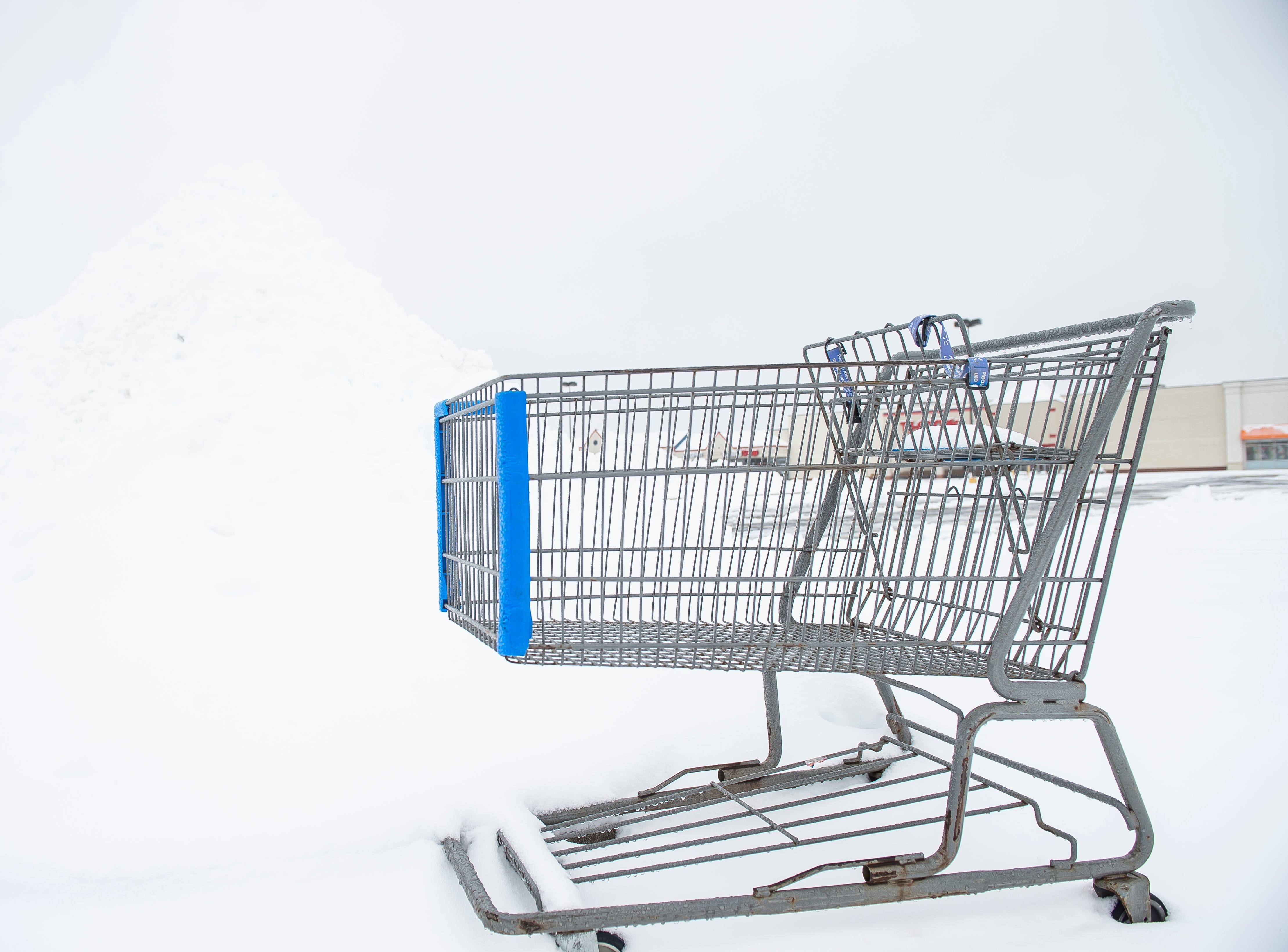 A shopping cart sits next to a pile of snow in the Hanover Crossing Shopping Center Wednesday, February 20, 2019.