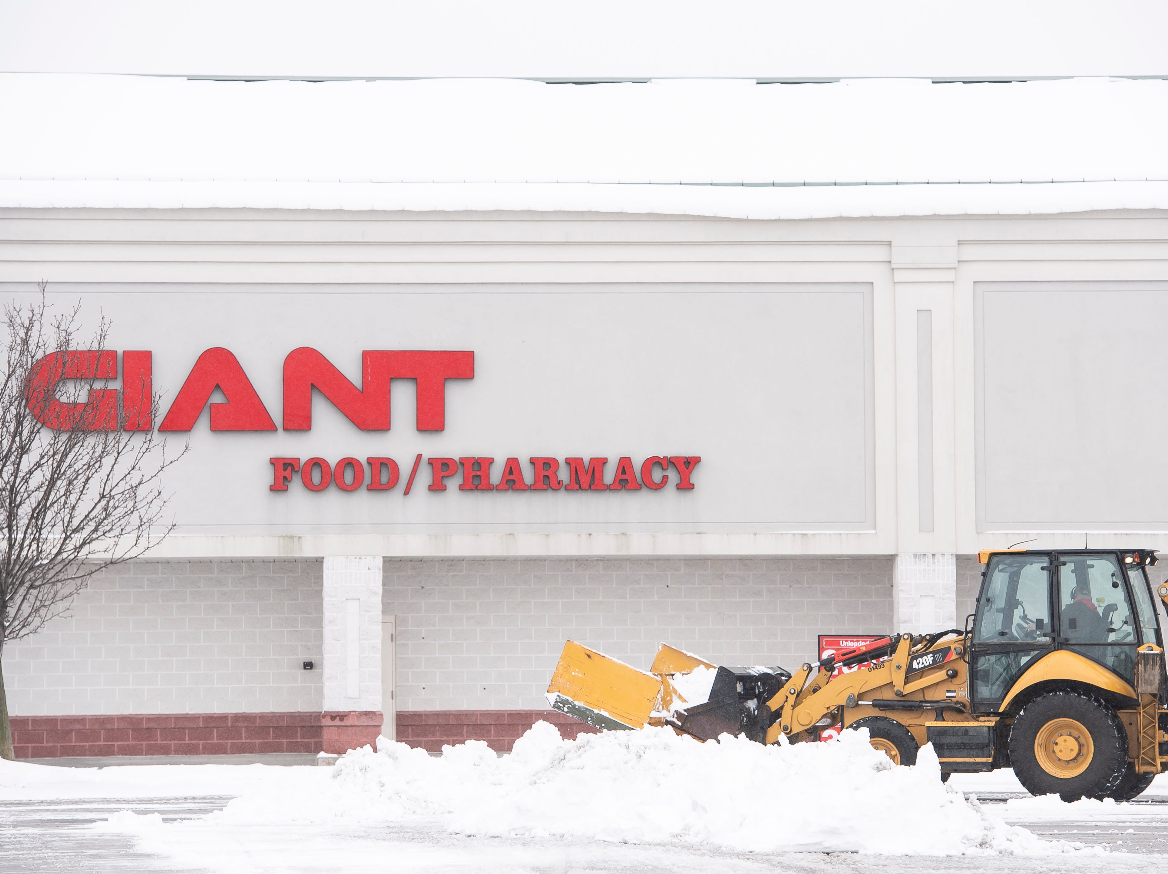 Snow removal commences outside the Giant Food at the Hanover Crossing Shopping Center Wednesday, February 20, 2019.