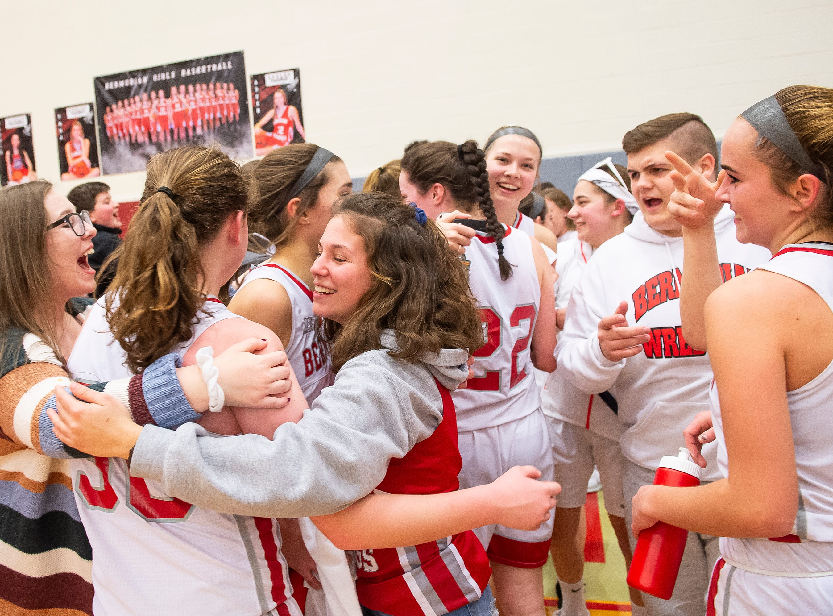 Bermudian Springs basketball players are greeted by students after downing Northern Lebanon 58-52 in the first round of the District III 4-A playoffs Tuesday, February 19, 2019.