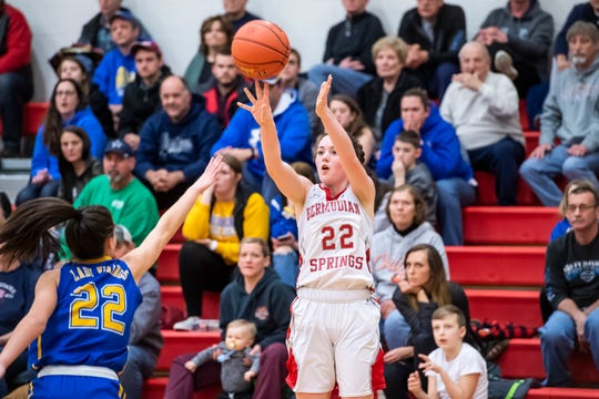 Bermudian Springs' Lillian Peters shoots and scores a 3-pointer over Northern Lebanon's Zara Zerman during play against the Vikings in the first round of the District III 4-A playoffs Tuesday, February 19, 2019. The Eagles won 58-52.