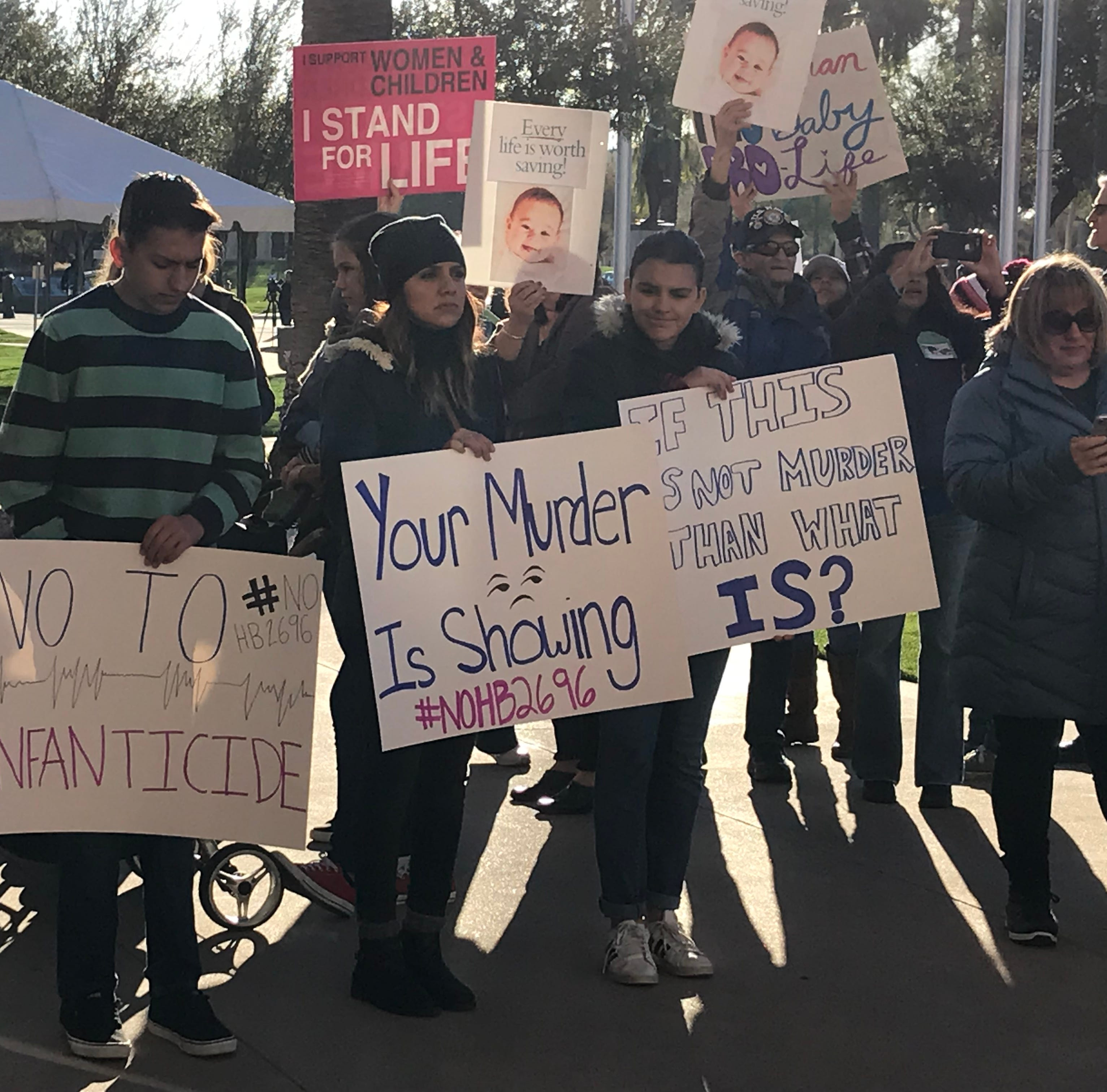 Hundreds protest bill to repeal Arizona law on babies born alive during abortions
