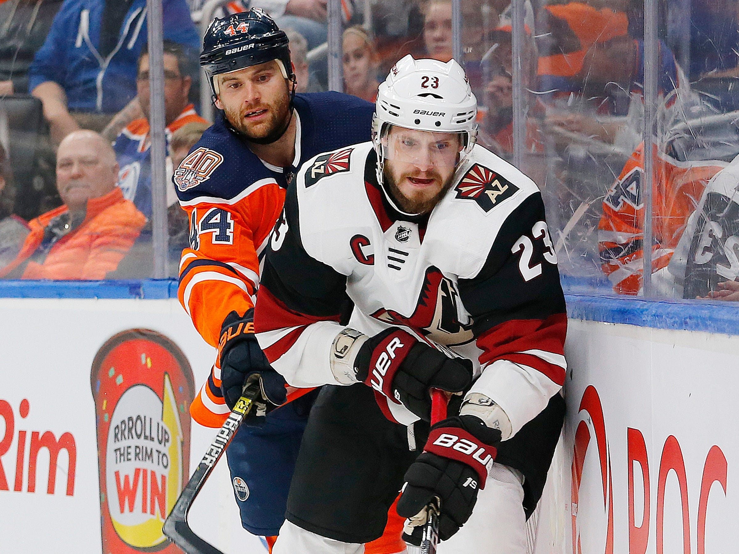 Feb 19, 2019; Edmonton, Alberta, CAN; Edmonton Oilers forward Zack Kassian (44) defends against Arizona Coyotes defensemen Oliver Ekman-Larsson (23) during the first period at Rogers Place. Mandatory Credit: Perry Nelson-USA TODAY Sports