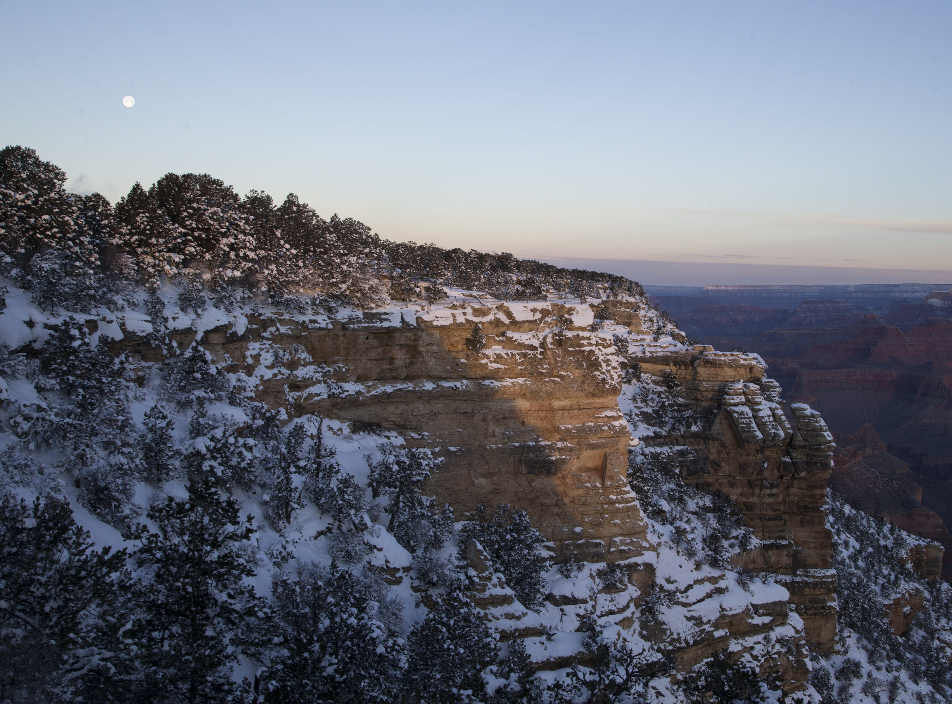 The full moon sets at Mather Point on Feb. 20, 2019, at the South Rim of Grand Canyon National Park, Arizona. The temperature at sunrise was 2 degrees.